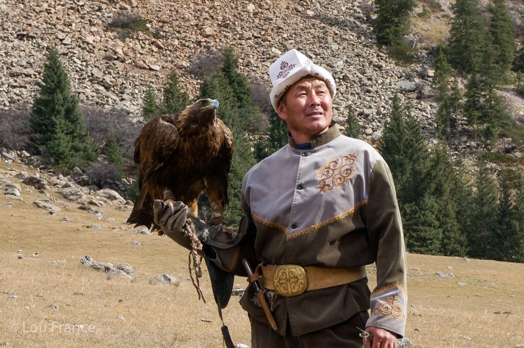 An Eagle Hunter with his Eagle. Seeing the Nomadic culture is a great reason to visit Kyrgyzstan