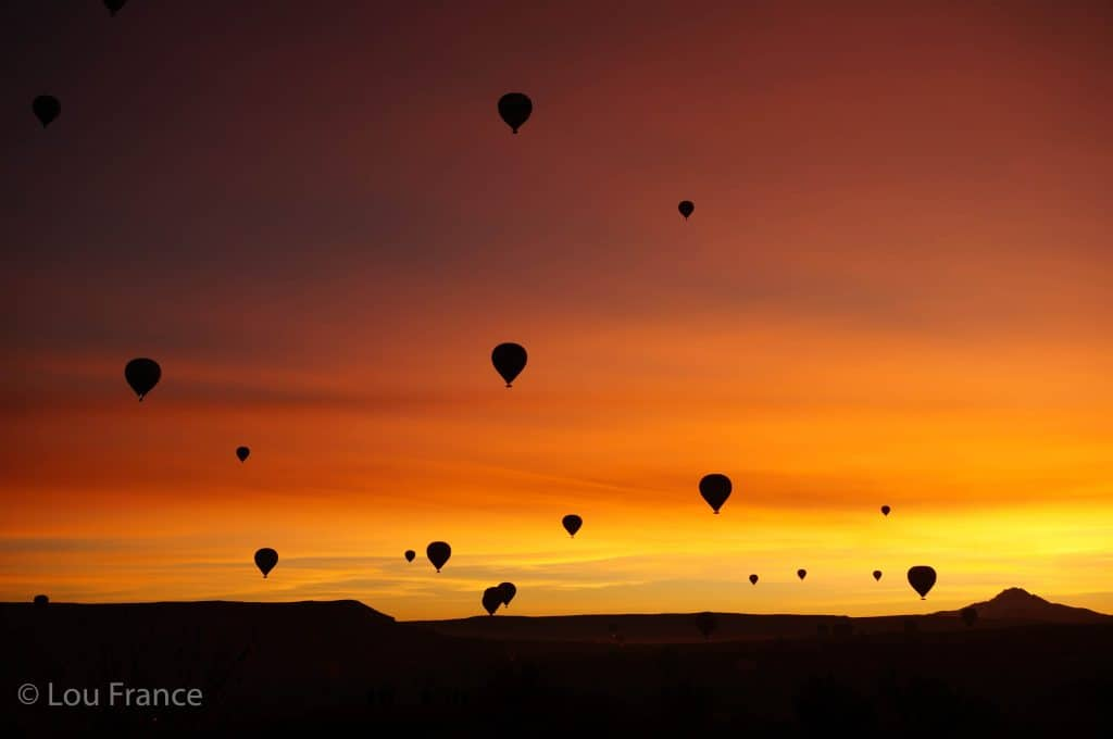 Watching hot air balloons at sunrise is one of the best things to do in Cappadocia