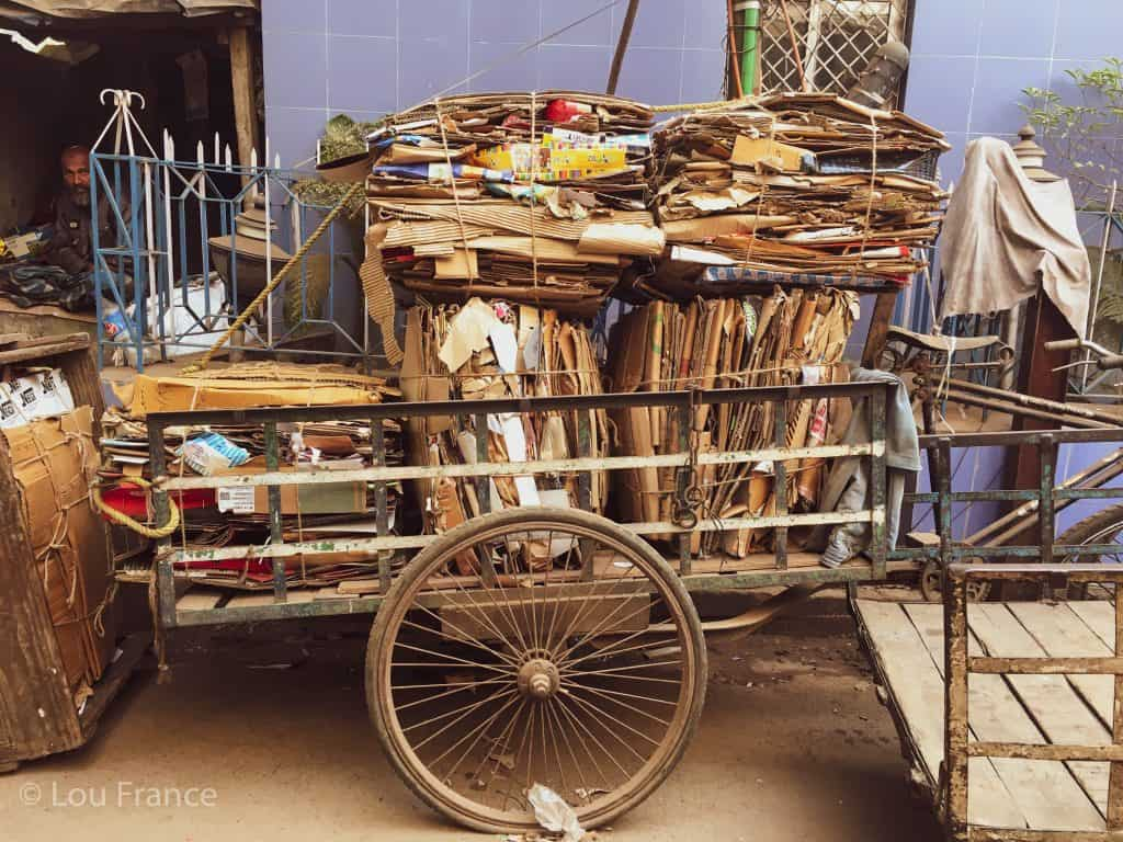 A rickshaw crammed with cardboard is a typical scene in Kolkata street photography